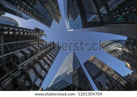 Looking directly up at the skyscrapers in London's financial district Royalty-Free Stock Photo #1201304704