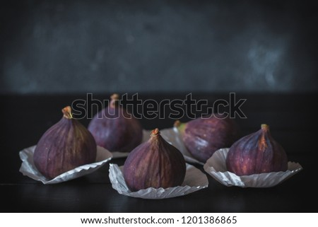 Fresh ripe figs on dark table. Healthy mediterranean fig fruit. Figs on white napkins #1201386865