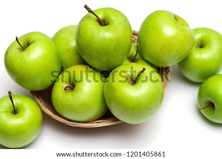 green apples in basket #1201405861