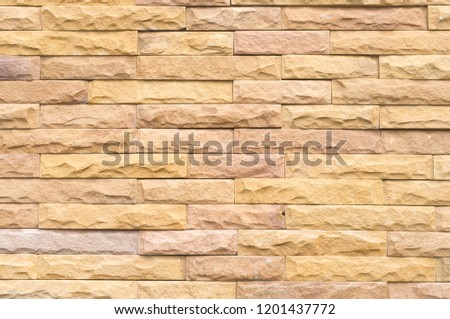 Beautiful yellow stone wall background in horizontal pattern for home or resident decoration #1201437772