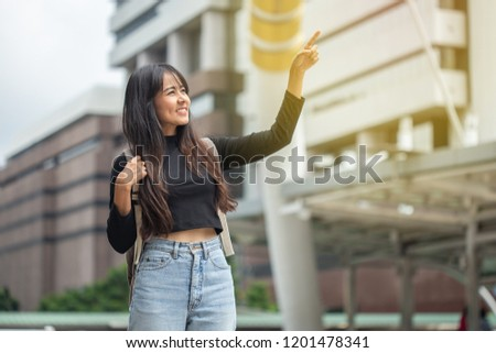 Portrait of asian young woman with backpack in the city #1201478341