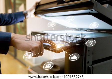 Bussiness man Hand press button on panel of printer with icon technology printer scanner laser office copy machine supplies start concept. #1201537963