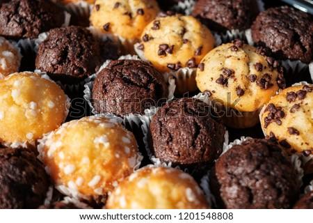 many mini muffins on dessert buffet - muffin closeup #1201548808