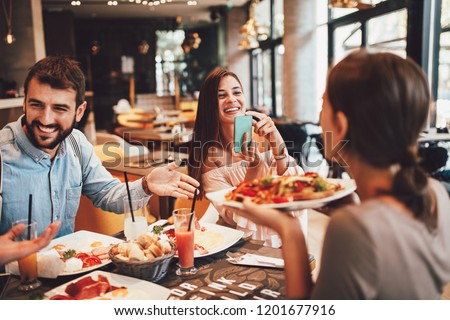 Group of Happy friends having breakfast in the restaurant #1201677916