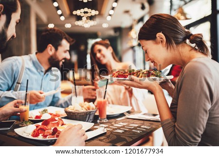 Group of Happy friends having breakfast in the restaurant #1201677934