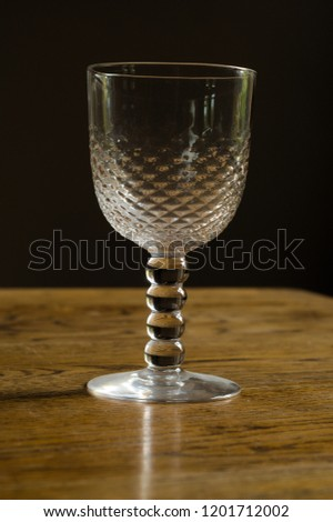 Decorated wine glass on wooden table  #1201712002