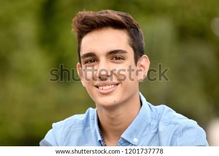 Smiling Hispanic Teen Boy #1201737778
