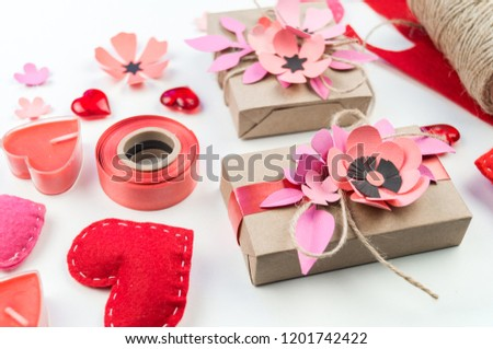 Gift wrapping for Valentine's day. Tools and decor for the holiday. Flower paper hack. Romantic setting. A gift with love. #1201742422