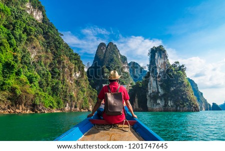 Man traveler on boat joy looking nature rock mountain island scenic landscape Khao Sok National park, Beautiful famous travel adventure place Thailand, Tourism destinations Asia holidays vacation trip #1201747645