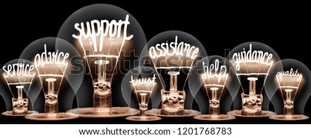 Photo of light bulbs group with shining fibers in a shape of SUPPORT concept related words isolated on black background #1201768783