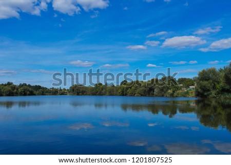 River in village. Summer rural landscape. #1201807525