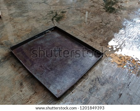 OLD OVEN BAKING PAN WET OLD METAL OVEN AND WET CEMENT #1201849393