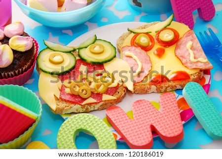 funny sandwiches with owl made from cheese ,sausage and vegetables for child #120186019