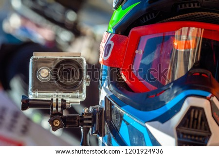 Action camera on a motorcycle rider's helmet #1201924936