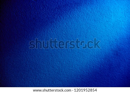 Beautiful blue background with a white glow in the middle #1201952854