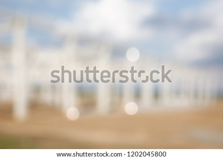 BLUR OF INDUSTRIAL BUILDING FRAME CONSTRUCTION BACKGROUND FOR BUSINESS USAGE #1202045800