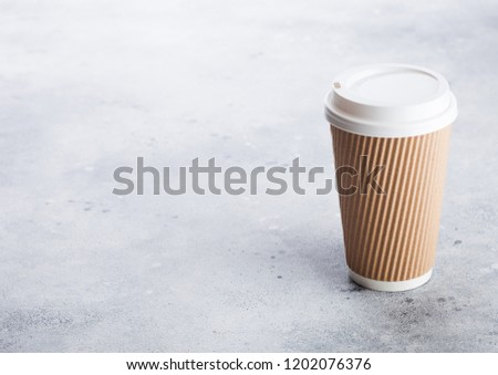 Coffee cardboard cup for take away or coffee to go on stone kitchen background. Brown color. Space for text. #1202076376
