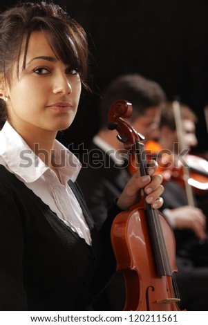 Classical music concert: Portrait of young woman violinist #120211561