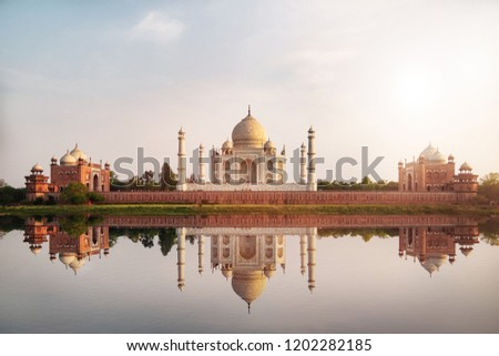 Sun set at Taj Mahal seen from Mehtab Bagh reflect on Yamuna river, an ivory-white marble mausoleum on the south bank of the Yamuna river in Agra, Uttar Pradesh, India.  #1202282185