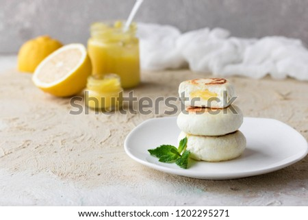 Cheese pancake on rice flour with lemon custard cream for breakfast on a light background #1202295271