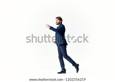 man in suit gesticulates with his hand                          #1202356219