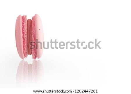 Pink macaroon on the white background. #1202447281