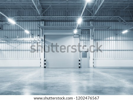 Roller door or roller shutter using for factory, warehouse or hangar. Industrial building interior consist of polished concrete floor and closed door for product display or industry background. #1202476567