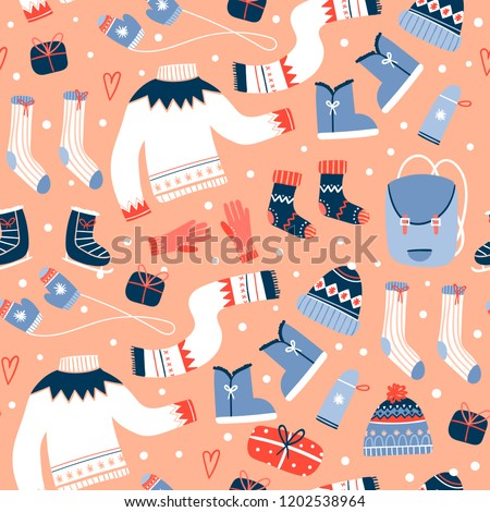 Cozy winter clothes and other stuff. Colored vector seamless pattern. Peach background #1202538964