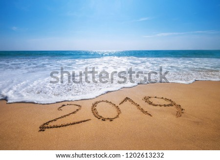 Happy New Year 2019 is coming concept sandy tropical ocean beach lettering concept image and  #1202613232