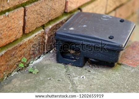 A black plastic rat trap. Pest control concept image.