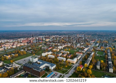 Aerial view of the city at sunset. Beautiful autumn city landscape.  #1202665219