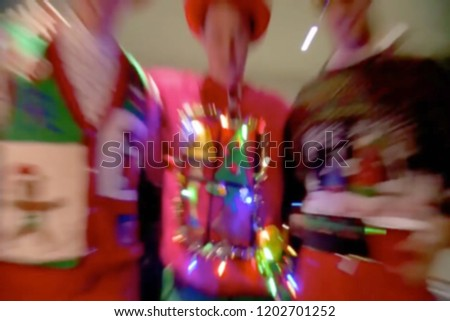 Abstract, blur, bokeh background, defocusing - image for the background. Christmas fun teenagers in new sweaters #1202701252