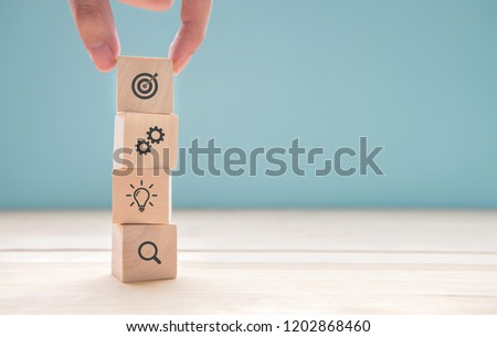 Businessman hand arranging wood block with icon business strategy and Action plan, copy space. Royalty-Free Stock Photo #1202868460