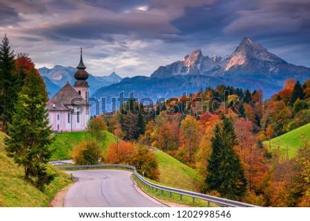 Autumn in Alps. Image of the Bavarian Alps with Maria Gern Church and Watzmann mountain during beautiful autumn sunrise. #1202998546