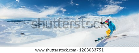 Alpine skier skiing downhill, panoramic format. Winter sports and leasure activities #1203033751