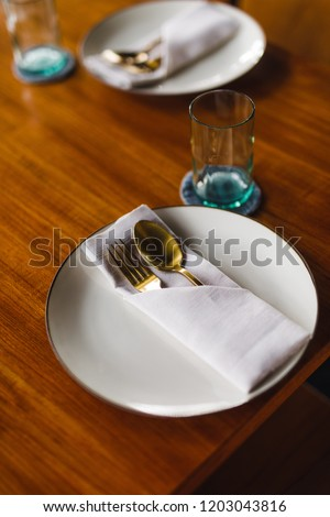F&B / interior photography - close up of silverware and table setting on fancy wooden table
