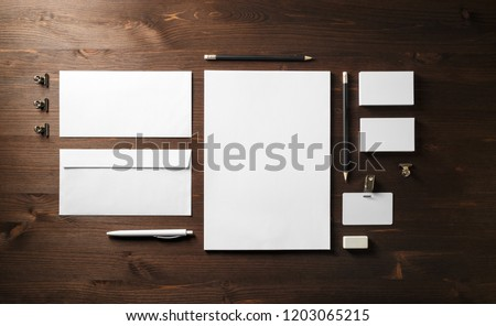 Blank corporate stationery set on wooden background. Branding mock up. Flat lay. #1203065215