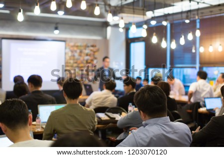Confident Executive Businessman Speaks to Group of People During Successful Meeting Presentation. Presenter Manager and Team Have Discussion on Technology Consulting. Management Communication. #1203070120