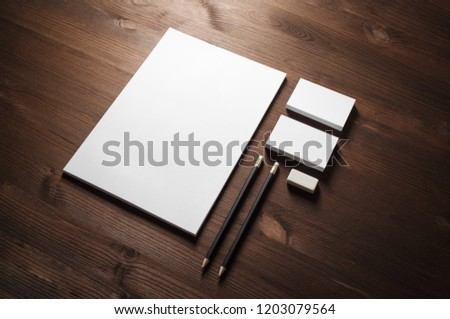 Blank corporate stationery set on wood table background. Template for branding identity.