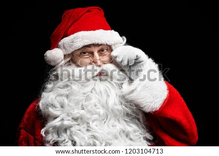 Portrait of cheerful santa claus with eyeglasses #1203104713