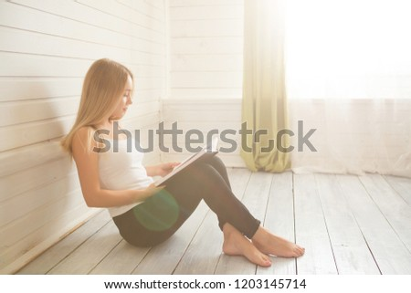 Student and education concept. Woman with book on the wooden white floor over window at home. #1203145714