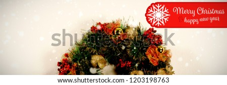Banner Merry Christmas against christmas crown made of branches with ornaments #1203198763