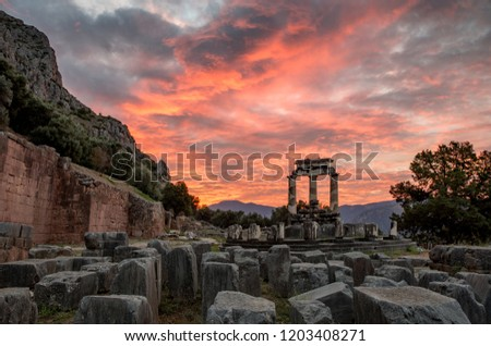 Sky on fire over the Temple to Athena Pronaia in Delphi #1203408271