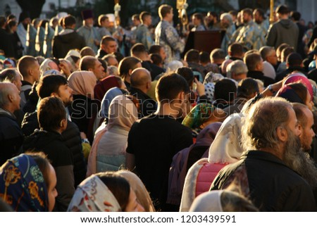 UKRAINE. KIEV - OCTOBER 14, 2018: Festive worship in the Holy Pokrovsky Convent of Kiev on the square in front of the Assumption Cathedral of the Kiev-Pechersk Lavra. #1203439591