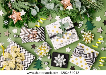 Flat Lay Christmas  Background with Gift boxs, Ribbons and Decorations in Green and Black colors. Flat lay, top view #1203454012