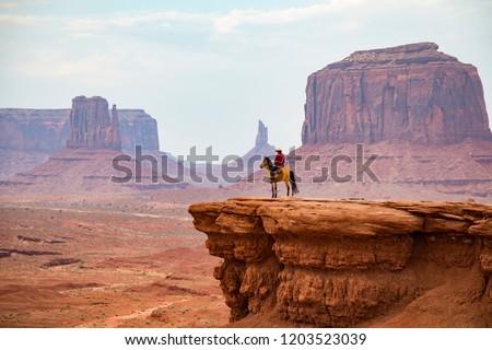 Cowboy looking at the horizon, Monument Valley Navajo Tribal Park