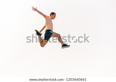Sports man training parkour while jumping in the air #1203660661