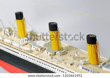 Handmade model of Titanic . Beautiful Handmade model of Titanic isolated on white background.  Royalty-Free Stock Photo #1203661492