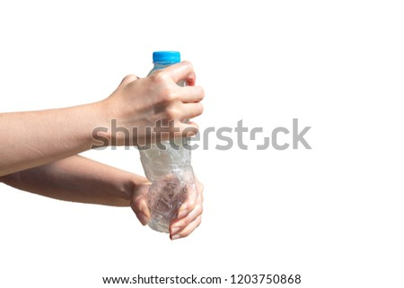 Two hands twisting clear plastic bottle on isolated white background and including clipping path, Resize plastic bottle before recycle, Global warming solution