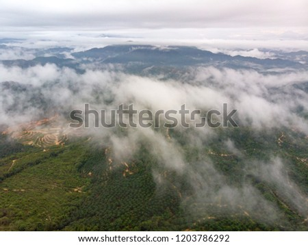 Beautiful aerial view of peak of the hills with clouds. #1203786292